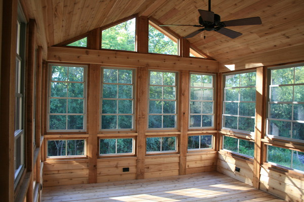 Sunroom screen room contractor three season rooms for Log cabin sunroom additions